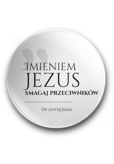 """""""Imieniem Jezus smagaj przeciwników"""" (przypinka, średnica - 56 mm)"""